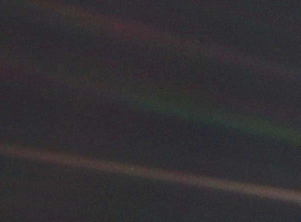 "The famous ""Pale Blue Dot"" photograph. Taken in 1990, 3.8 billion miles from earth, which is a tiny dot in the bottom-center of the image."