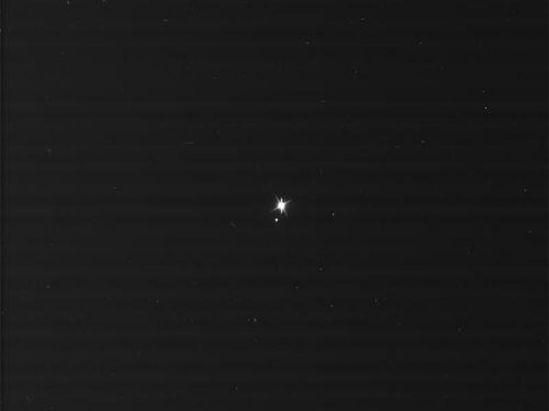 "Earth-moon system as photographed by NASA spacecraft Cassini.  ""The Day Earth Smiled"" was taken from approximately 900 million miles away on July 19, 2013."