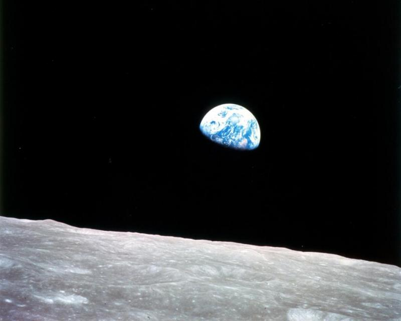 """Earthrise,"" taken aboard the Apollo 8 spacecraft in 1968. The rocky surface in the foreground is our moon."