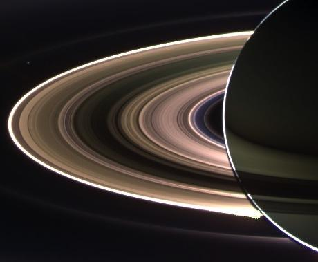 "Earth ""photobombing"" a solar-eclipsing saturn (our planet is the small dot in the upper left). Taken in 2006, this picture, ""In Saturn's Shadow,"" is inspiration for today's earth-photograph."