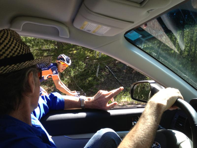 Ed Beamon talks with pro cyclist, Thomas, about surviving the climb up Independence Pass.