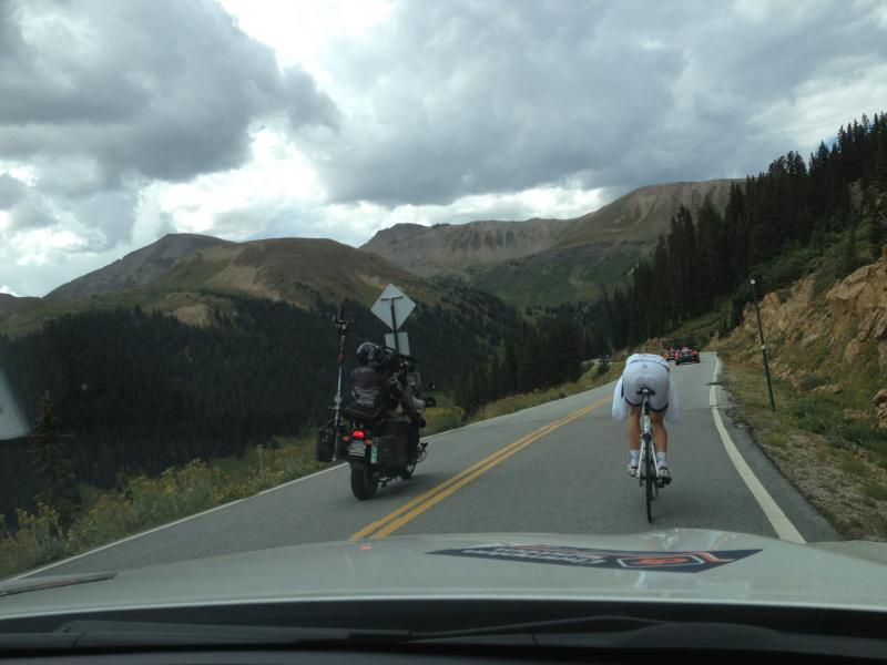 Novo Nordisk pro cyclist and TV cameraman descending Independence Pass. August 20th, 2013.
