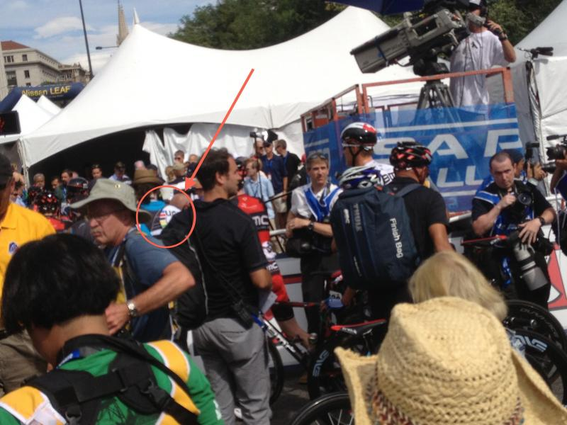 UCI chaperone follows a cyclist selected for anti-doping testing after Stage 7 finish, 2013 USA Pro Challenge.