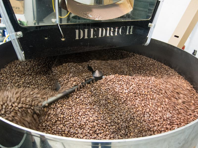 After leaving the roaster, beans must cool in a large tub. Large arms spin them around so they'll cool evenly.