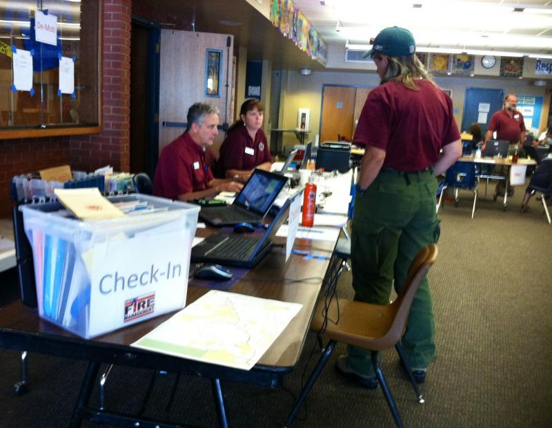 When the Type Two team arrived in Carbondale, it set up shop inside an elementary school. There, personnel examined maps, kept track of the fire's costs and worked on other logistics.