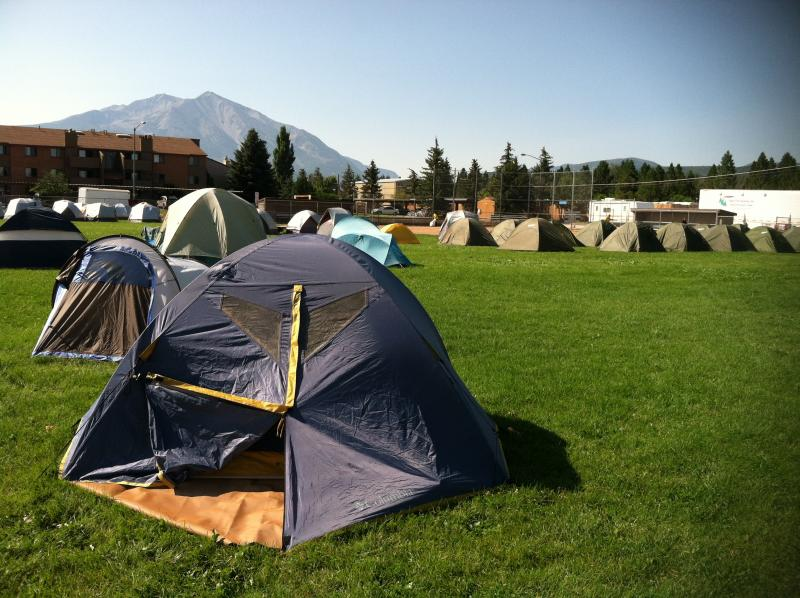 In August, firefighters set up tents in a field in Carbondale so they could fight the Red Canyon Fire.