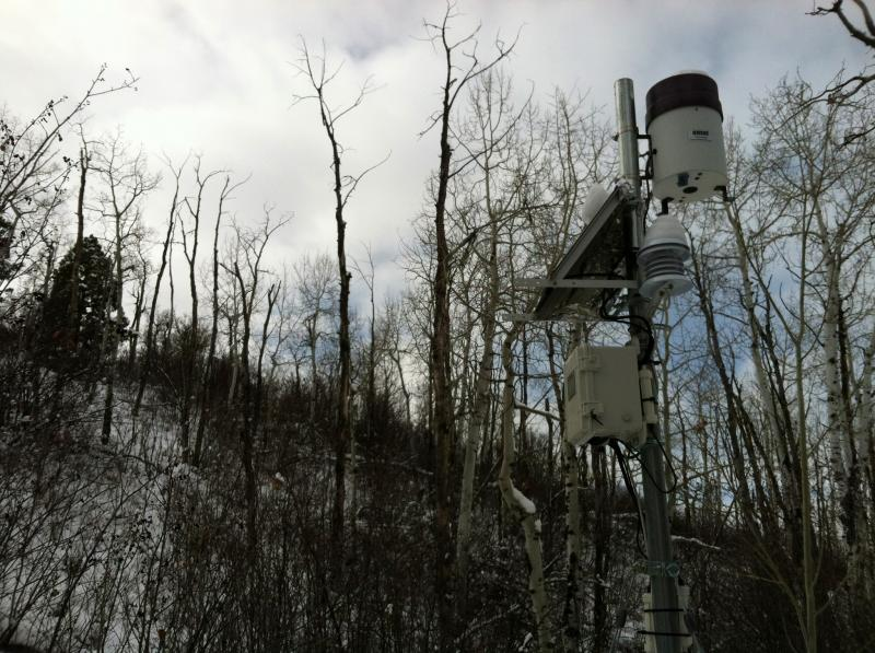 The rain gauge at the top of the tower is just above a solar panel that powers the tower. It sends real-time data to a computer several miles away.