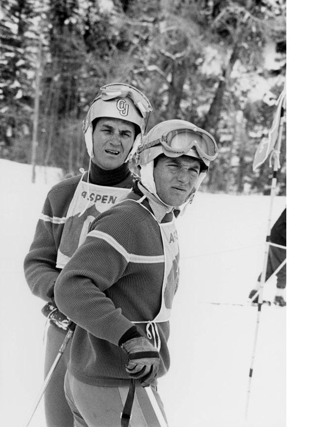 1964 Olympian Bill Marolt stands behind U.S. Ski Team member Billy Kidd