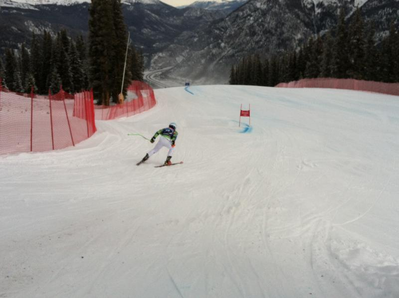 A ski racer zooms down the course going upwards of 65 miles per hour.