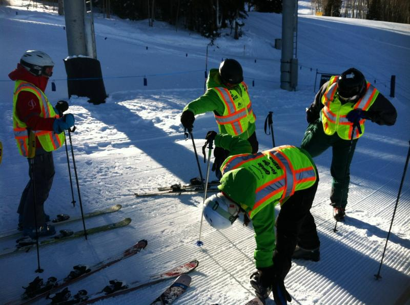 The group stretches before taking to the slopes. Two skiers in the group are legally blind.