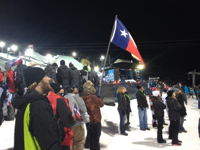 Austin Wilson, family friend of Caleb and Colten Moore, watches as results of the X Games 2014 Snowmobile Freestyle event.