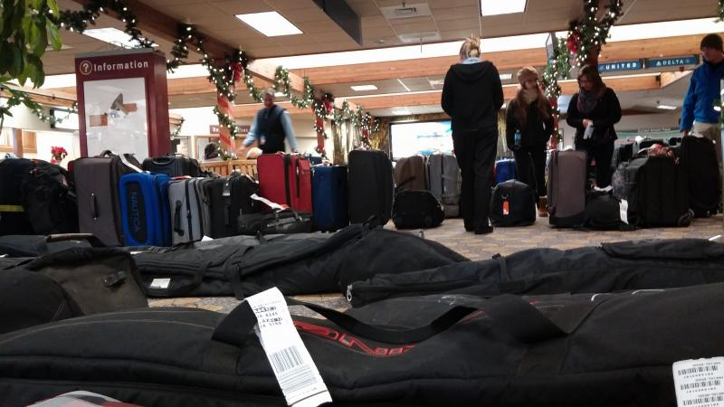 Travelers Looking for Bags at the Aspen Airport - January 6th, 2014