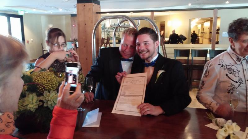 Larry McDonald & Brett McNamee smiling after signing their Civil Union certificate at the Limelight Hotel in Aspen, Colorado on January 18th, 2014