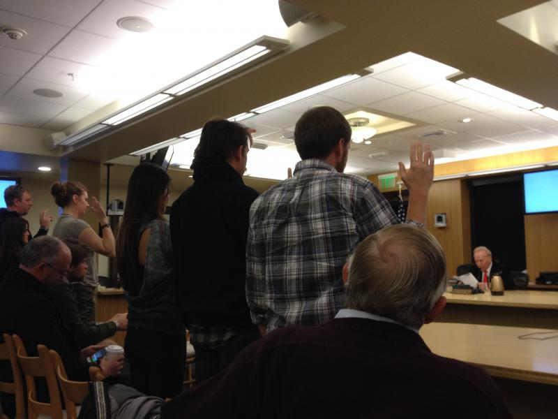 Jurors take the oath at the beginning of a jury trial.