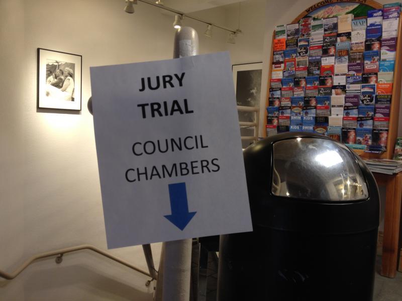 Sign greeting potential jurors, Aspen City Hall.