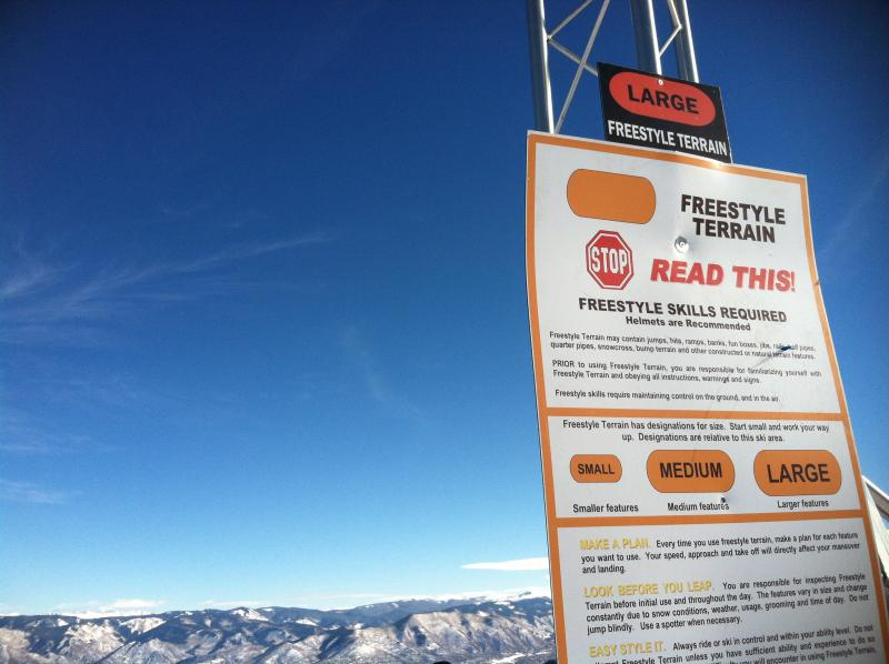 """Orange ovals mark the entrance to """"Large"""" terrain park features at Snowmass. These jumps and rails are meant for advanced skiers and riders."""