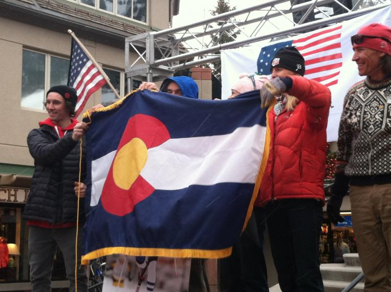 Freeskier Torin Yater-Wallace and family members of Simi Hamilton, Noah Hoffman and Jeremy Abbott hold a Colorado flag during an Olympic send-off in downtown Aspen.