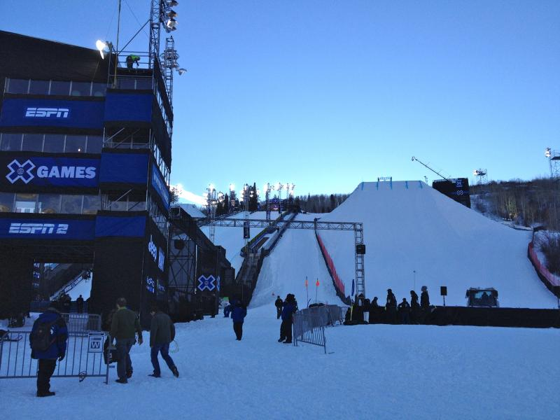 Workers put the finishing touches on the tower and park features at the Winter 2014 X Games.