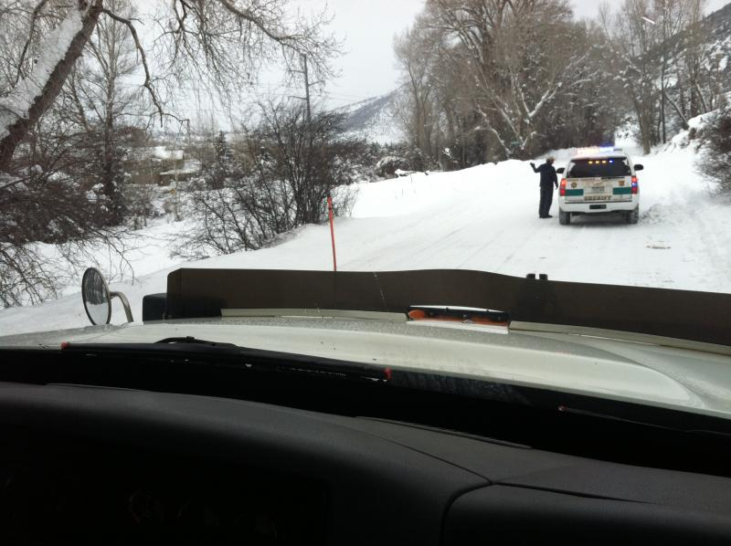 Driver Scott Mattice stops for a disabled vehicle along Lower River Road. He calls a Sheriff's deputy to the scene.
