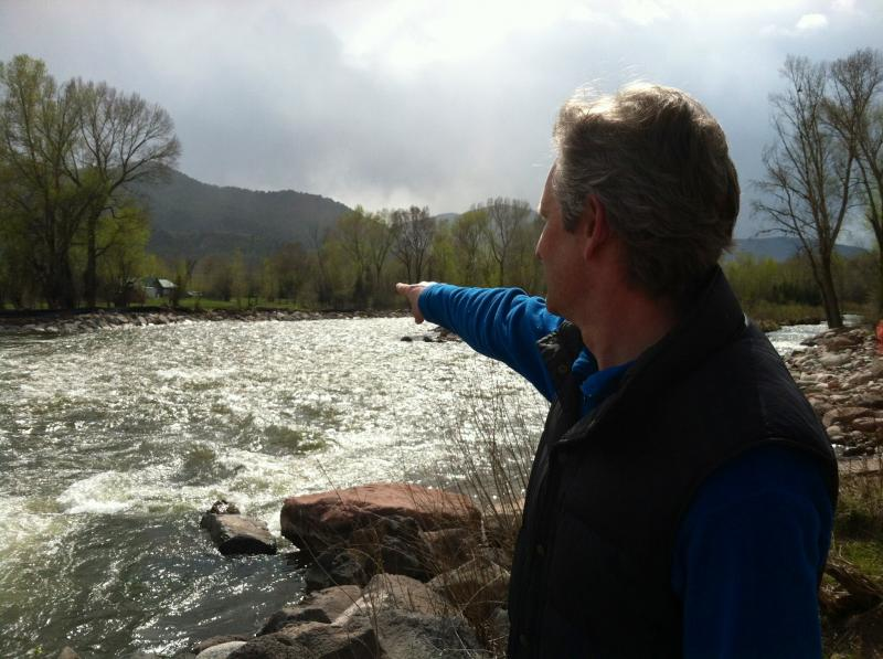 Town Manager Mike Scanlon points toward a wide channel of the Roaring Fork River. This stretch has been modified to keep floodwaters out of the old trailer park. Crews are now repairing the riverbank to prevent further erosion.