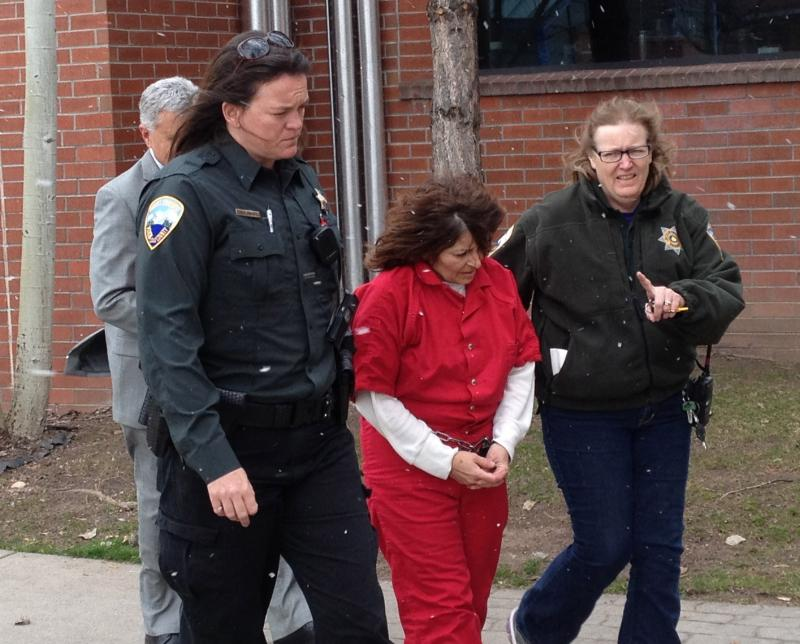 Kathy Carpenter is escorted from the Pitkin County Jail. March 26th, 2014.