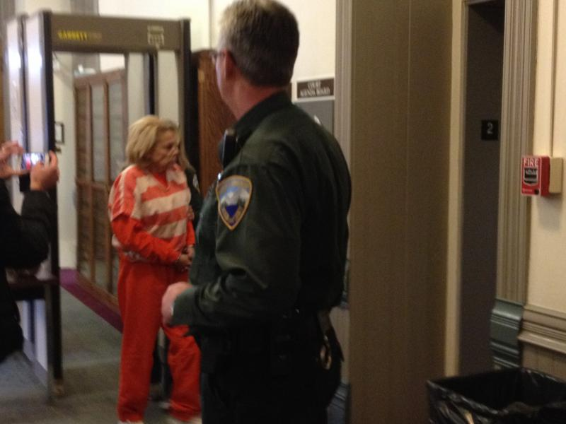 Nancy Styler, wife of William Styler, leaves court proceedings on March 4th, 2014.