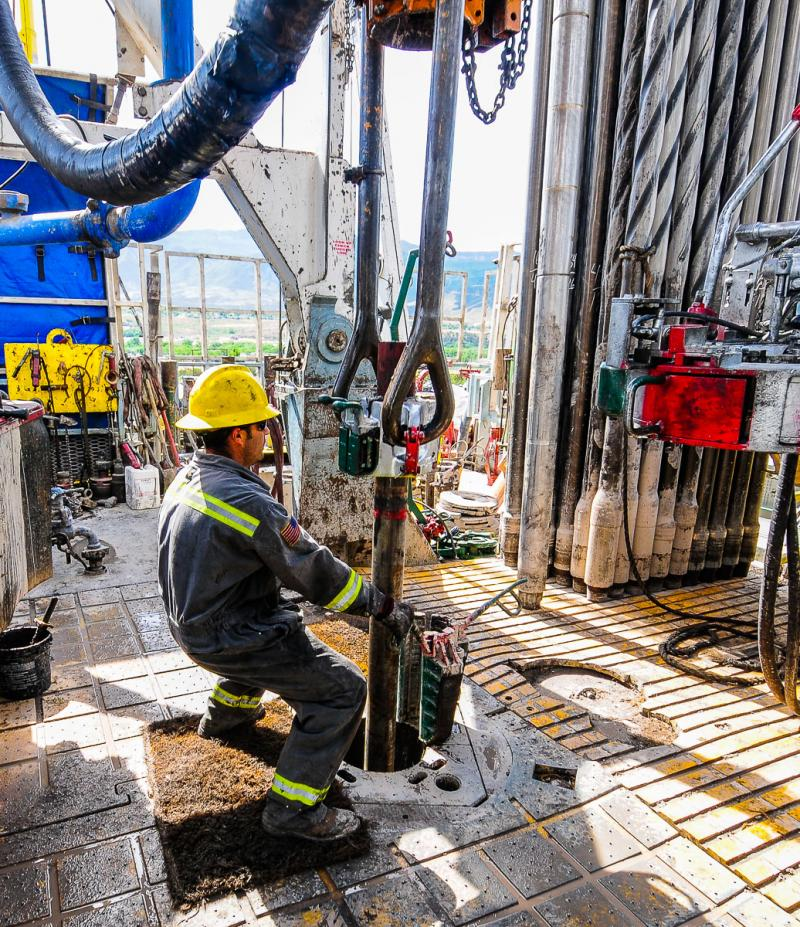 Drilling hand connecting well casing.