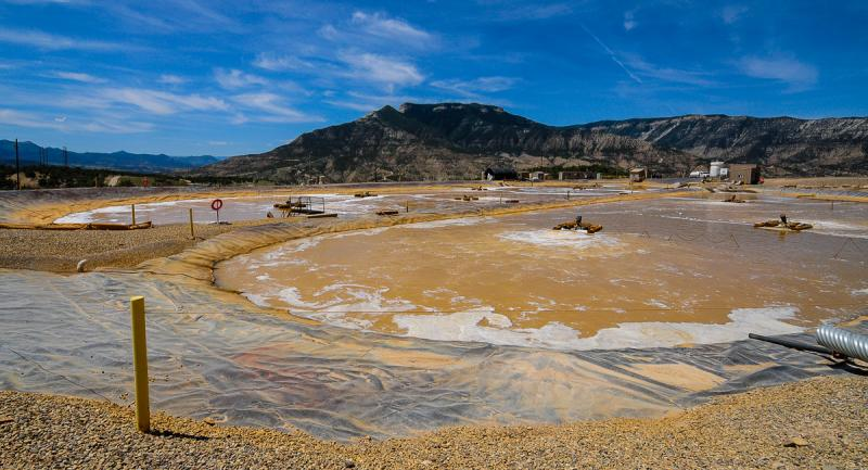 Recycled and cleaned produced water is aerated in collection ponds in preparation for use in future frack jobs. The brown color is caused by bacteria introduced by WPX to remove all of the hydrocarbons to a non-detectable level.