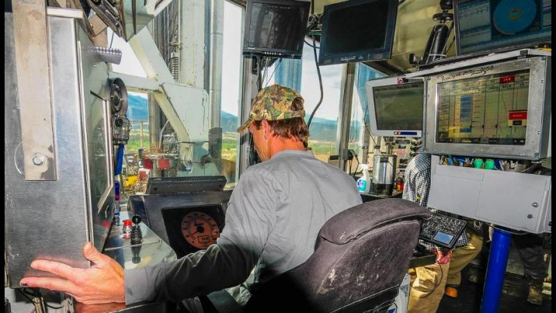 """Driller Dave Duke controls the drilling string while monitoring pressures, torque, weight, distance, speed, and many more parameters from the """"dog house."""""""