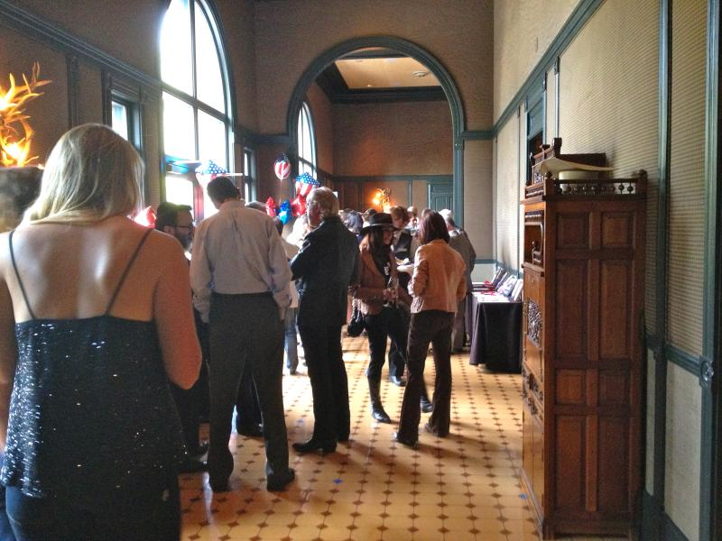 Attendees mingle in a lobby at the Hotel Jerome beforehand.