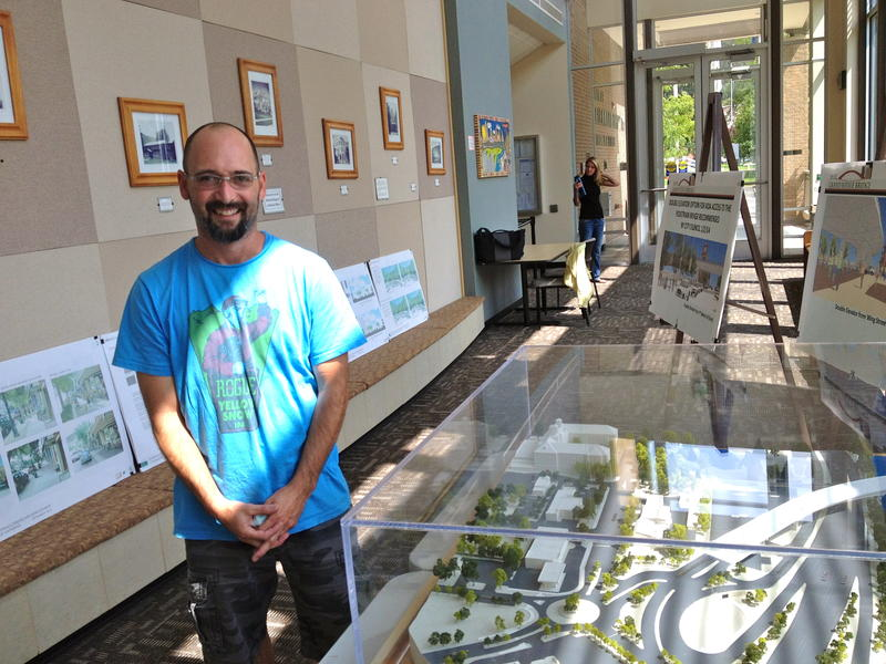 Glenwood Springs Mayor Leo McKinney stands next to a model of the proposed bridge, at City Hall.