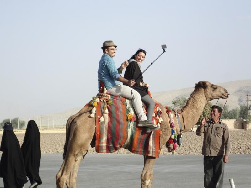 """Taking a """"selfie"""" on camel back."""