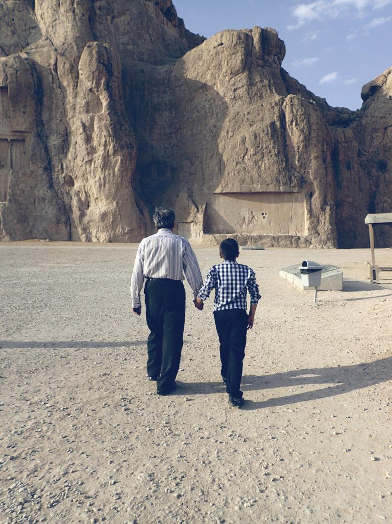 Older man and boy walking.