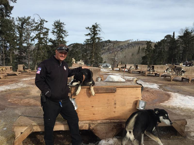 Danny Phillips stands with one of the older dogs at Krabloonik Fine Dining and Dogsledding in Snowmass Village.