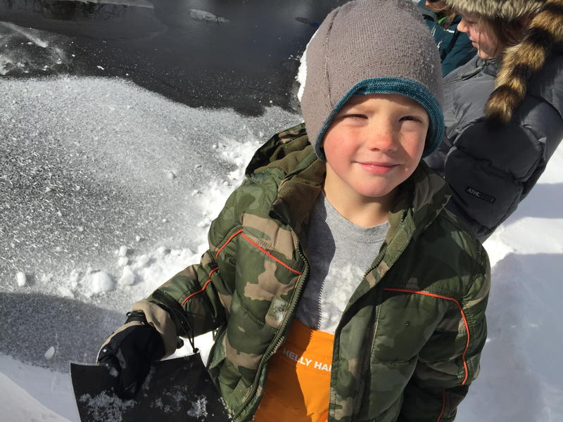 Six-year-old Quintin holds crystals gathered from the frozen surface of a pond at Hallam Lake.