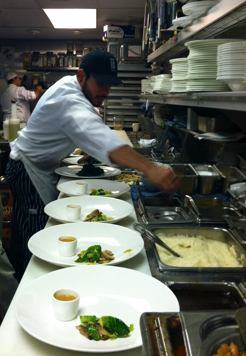 "The ""back of the house"" kitchen staff prepare meals for people dining at Cache Cache."