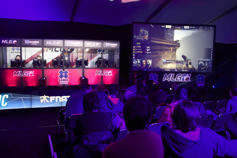 Spectators watch the first round of the Counter-Strike: Global Offensive eSports competition.