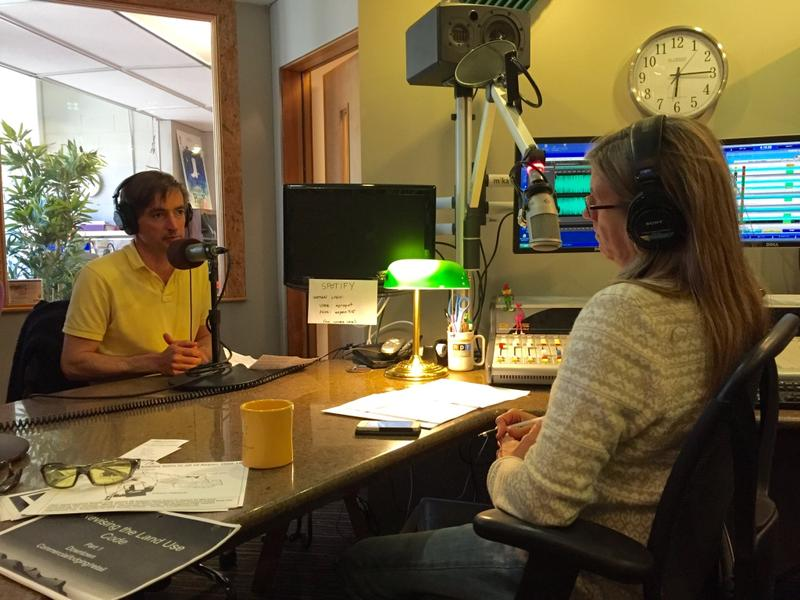 Moderator and Aspen Public Radio's News Director, Carolyne Sackariason, listens as Myrin explains his platform.