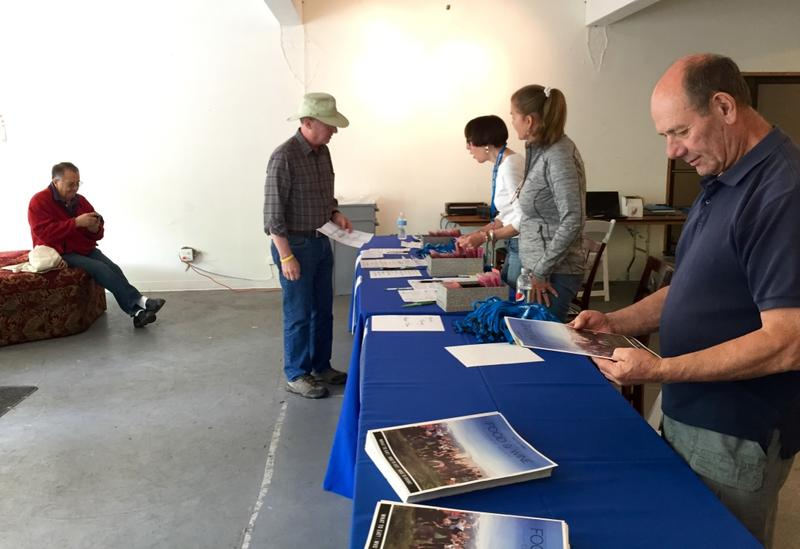 Volunteers check in for the Food & Wine Classic.