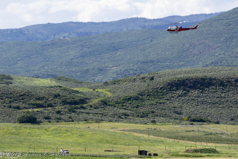 Two helicopters dropped water on the blaze that burned in dry juniper, pinyon and sagebrush.