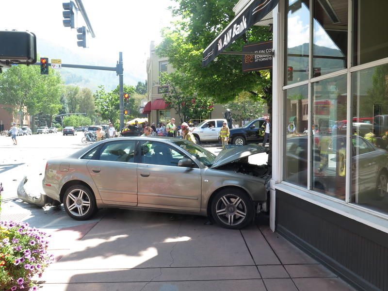 The impact of a two-vehicle crash at the corner of Mill and Main Streets in Aspen sent an Audi over the curb and into the entrance of ANB Bank.