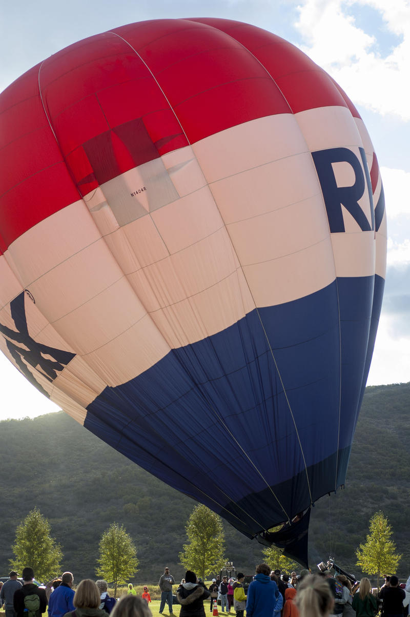 As the sun begins to rise, balloons are inflated.  The classic RE/MAX balloon made an appearance at the event, though it did not make it off the ground.