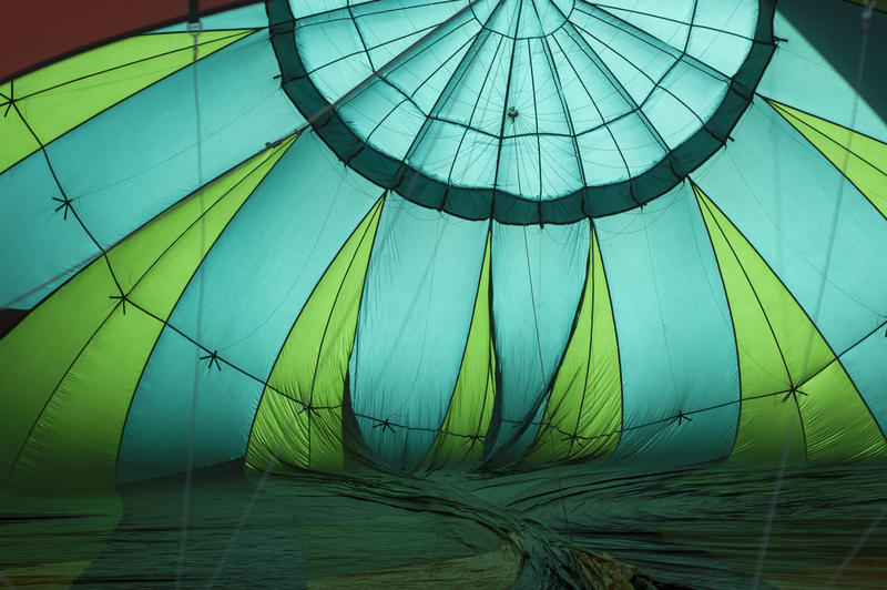 Hot air balloons vary in size, shape and color depending on their purpose. This is a view inside of a balloon as it is inflated.