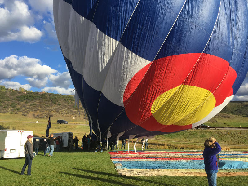 The Colorado Flag balloon has been flying for quite some time. It was the first to inflate, but in the end decided that it was indeed too windy to fly.