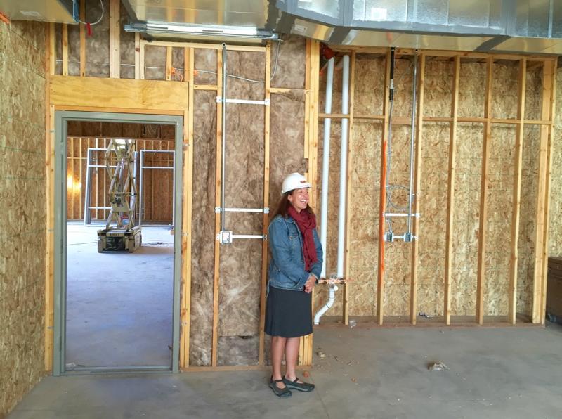 Development Director Tricia Williams stands inside a kindergarten room in the new Ross Montessori school.
