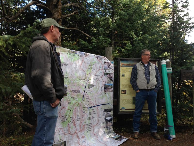 Bruce Hughes (left) and Rick Kienitz explain the network of streams, ditches, canals and diversion structures on Independence Pass.