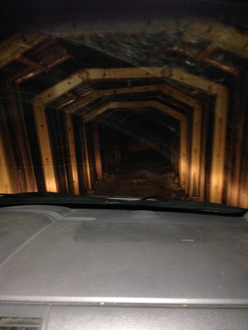 Headlights illuminate the inside of the Twin Lakes Tunnel.