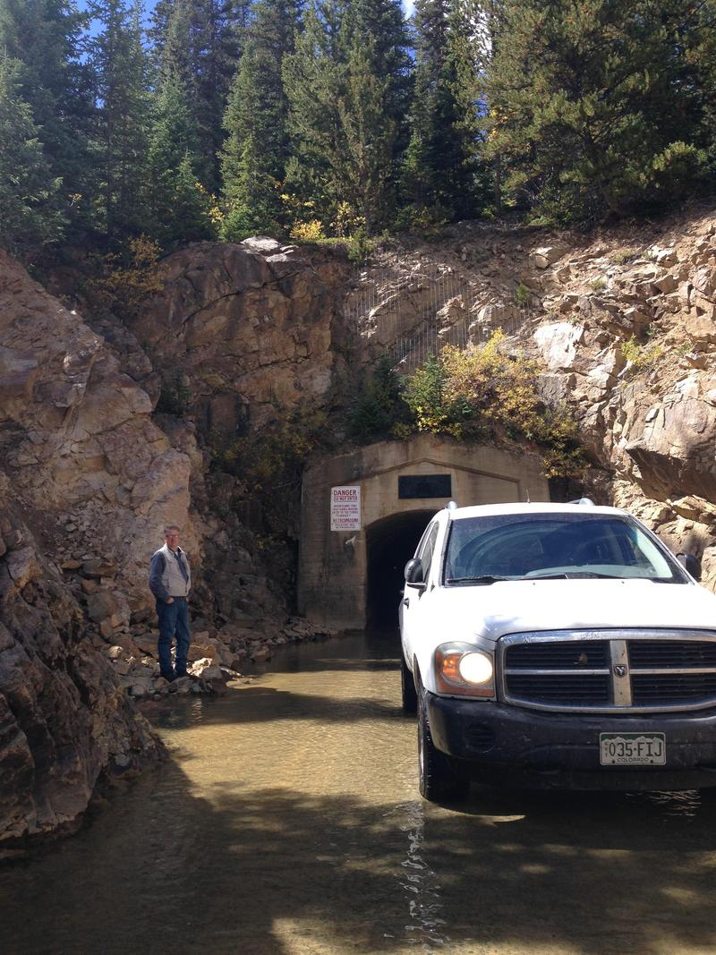 Rick Kienitz stands by his car after driving the four miles through the Twin Lakes Tunnel.