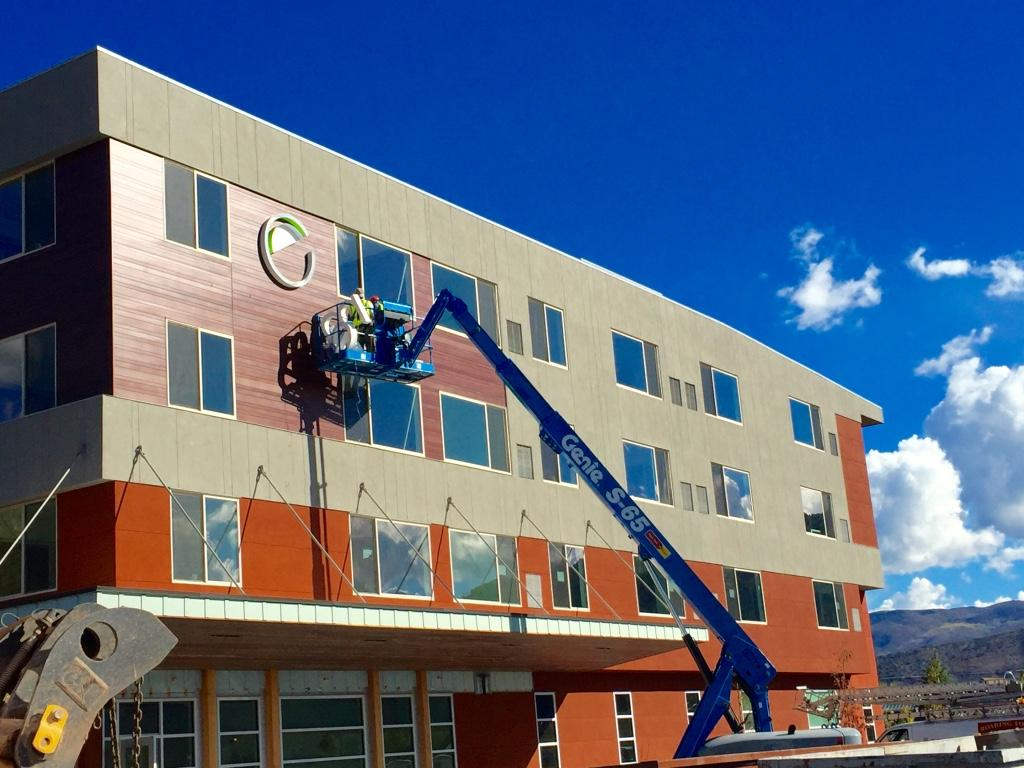 Construction Workers Install The Logo On Side Of Element By Westin Basalt Aspen Hotel In Willits Town Center
