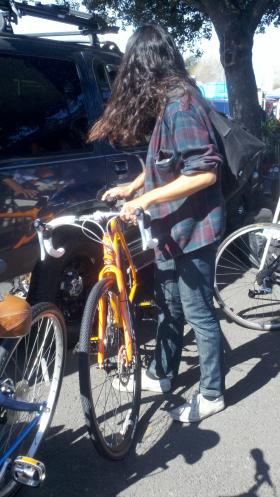 Jun Takeda checks out a bike at the Laney Flea Market
